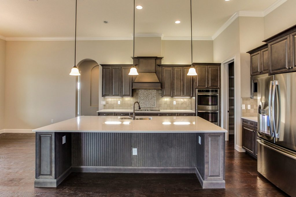 New Kitchen Construction with Marsh Cabinets, Stanisci Hood, and Cambria Countertops Hammond Kitchens & Bath Melbourne FL