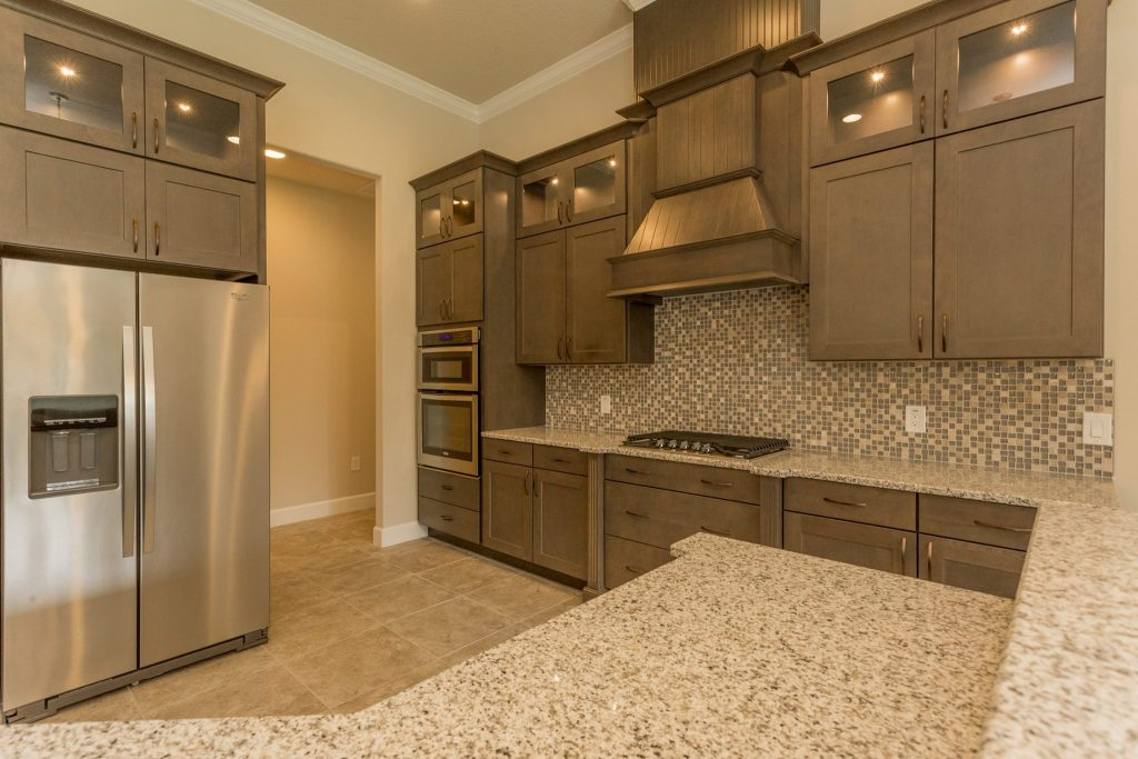 new kitchen cabinets and granite countertops in Melbourne FL by Hammond Kitchens & Bath